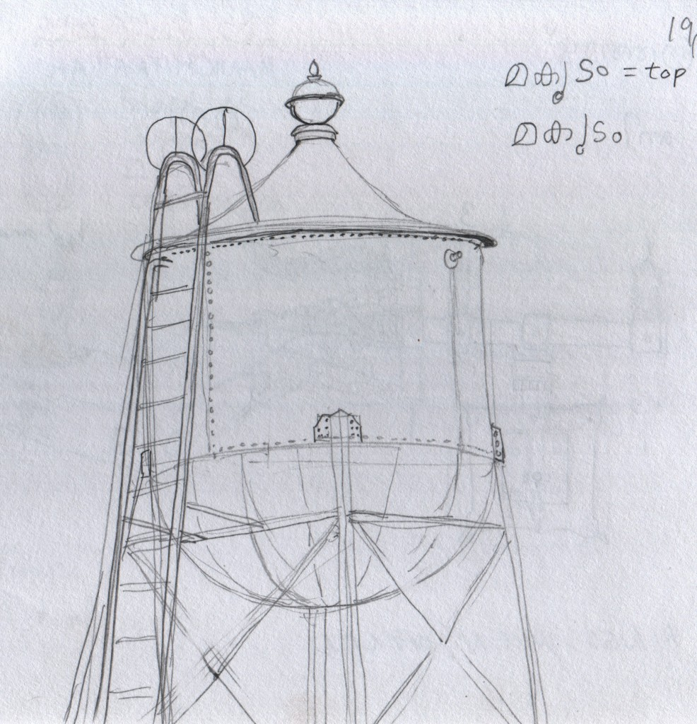 """Riveted steel water tower with a finial on its roof at Hill Palace Museum, Thripunithura.  Other museum visitors told me that the top is copied from temple architecture. The visitors told me that the name for the top is """"makutam"""",  which perhaps translates as """"sceptre"""" or ornamental top."""