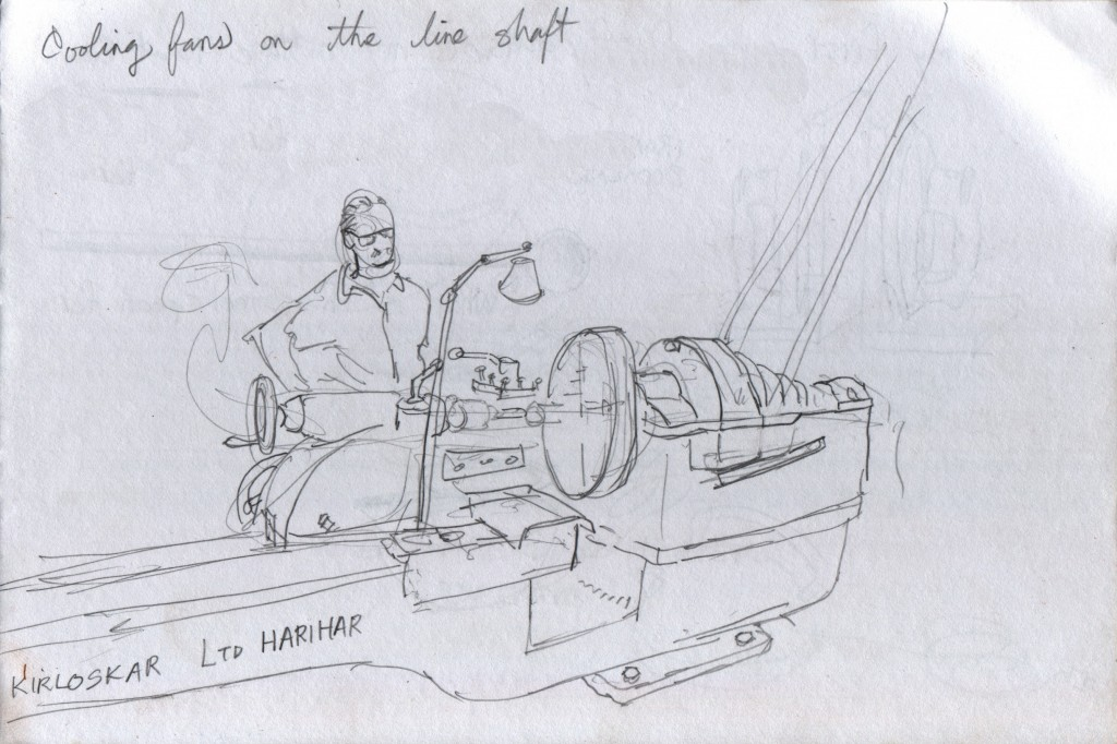 I paused outside a machine shop to see some of the boat parts that they were repairing. The proprietor, when he learned that I like to draw, asked me to draw him working at his lathe. I was honoured and delighted to do so. A single electric motor powers two lathes via a line shaft. In addition, two ceiling fans get their power from the line shaft. Each fan is angled toward the lathe operator, cooling him with a breeze while he works. The lathe is a domestically produced model, by the company Kirloskar.